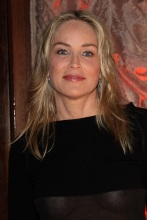 sharon_stone_see_trough_top_at_amfars_inpiration_night_in_paris_04